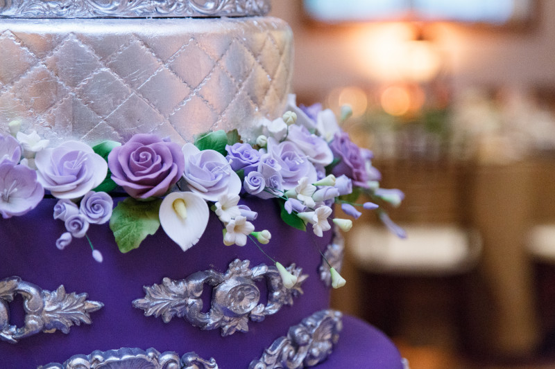 Intricate flowers on wedding cake
