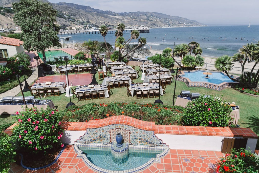 Surfers, sunbathers, gulls and waves are all part of the ambient noise of Adamson House weddings in Malibu, CA
